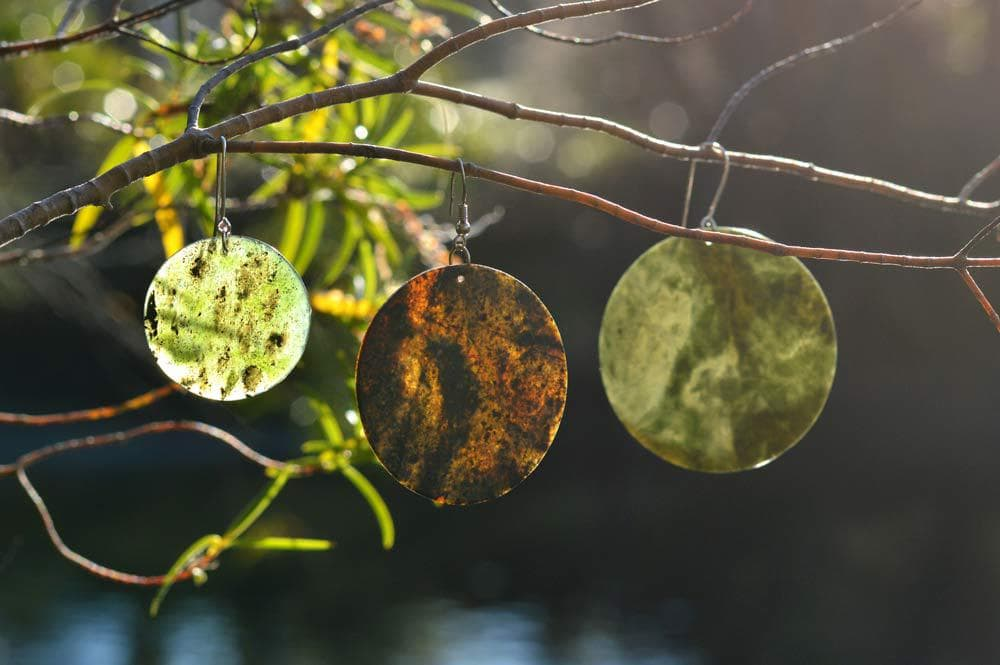 3 pounamu earrings in tree