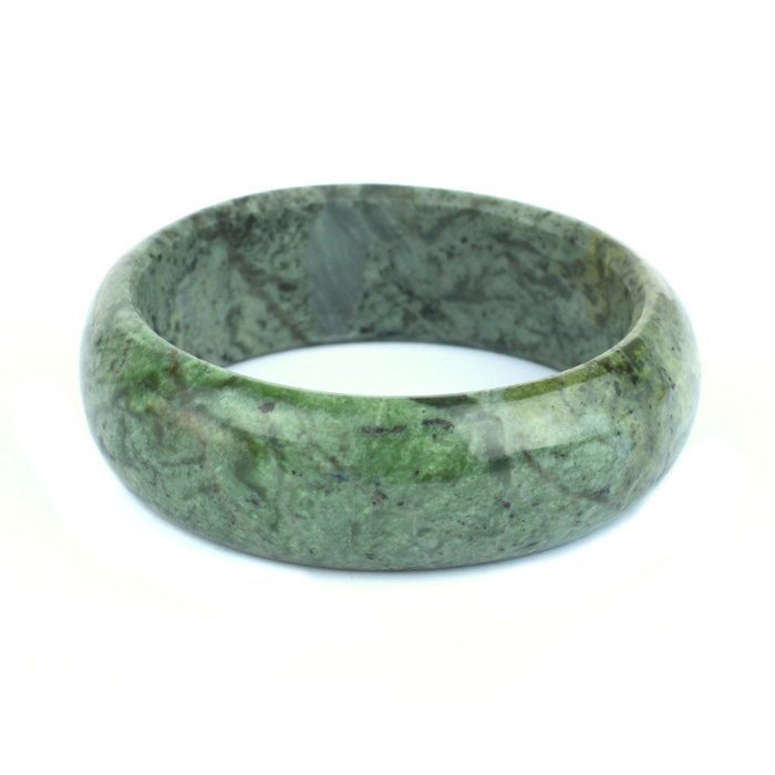 green and silver river jade pounamu bangle chatoyant inclusions