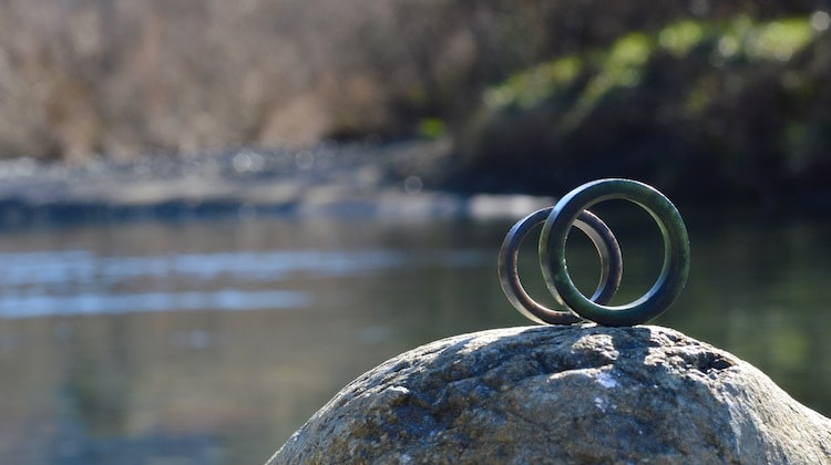tangiwai and black pounamu rings on rock