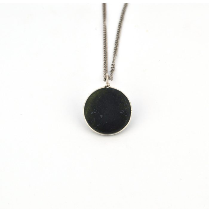 Small round Tangiwai pounamu pendant for child, with silver edge