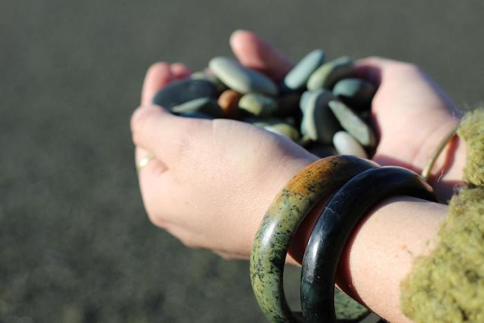 pounamu bangles on hand