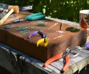 work bench with tools for making sterling silver earring hooks and findings
