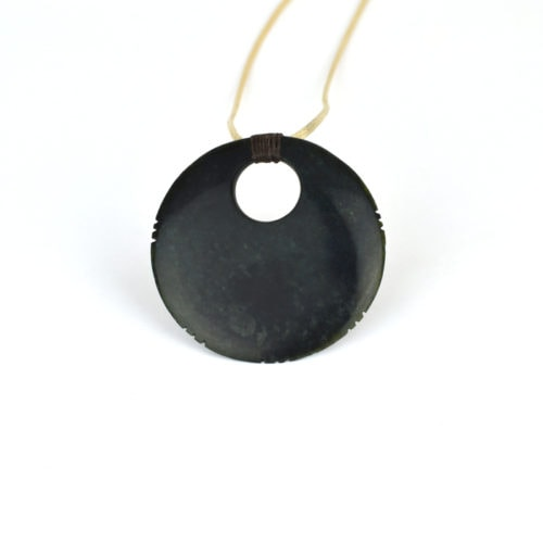 Tangwai disc pendant with whakapapa notches