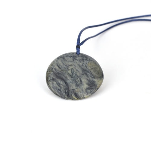 Chatoyant and Dendritic silver blue Tāwhirimātea pounamu disc pendant with yellow rind
