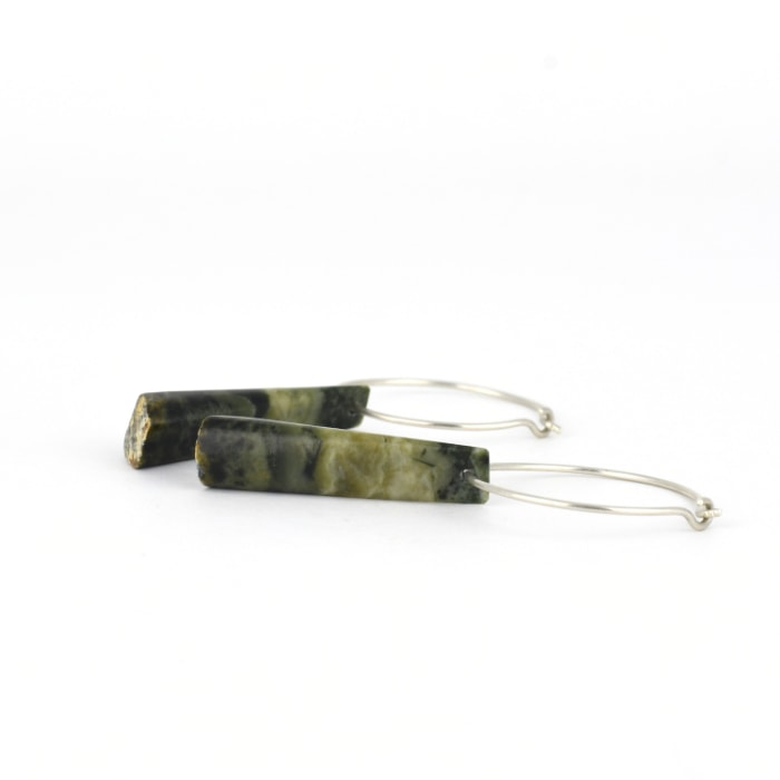 Unique pounamu wedge earrings with stunning patterns, on sterling silver hoops