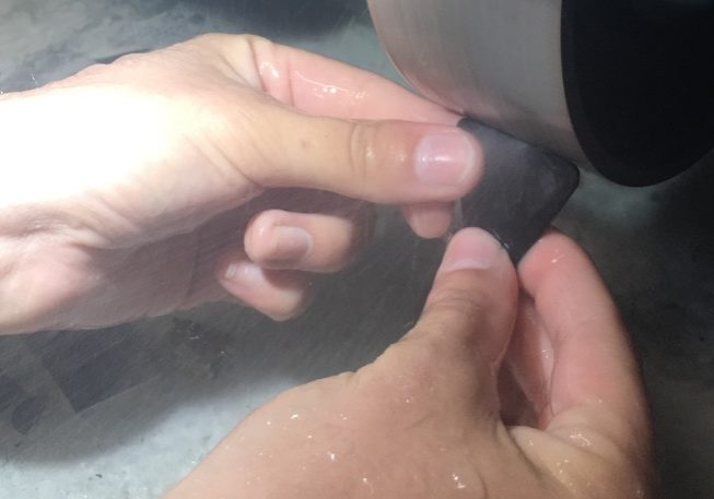 carving a pounamu guitar pick
